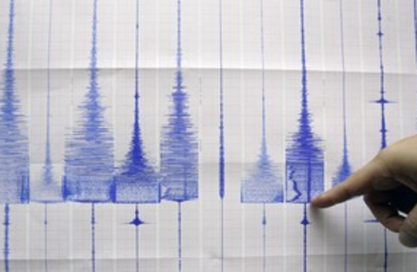 Richter Scale, earthquake quake hand graph 311 (R) (photo credit: Pichi Chuang / Reuters)