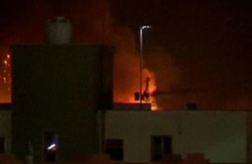 Tripoli rocked by explosions (photo credit: REUTERS)