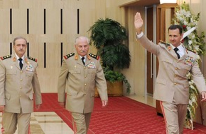 Assad with defense minister and chief of staff 311 (photo credit: REUTERS/Sana)
