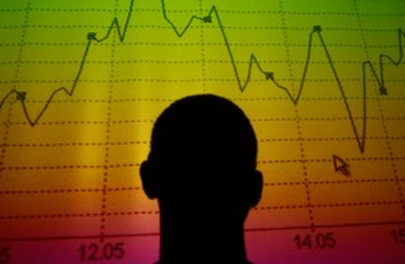 Trader looks at market graph 311 (R) (photo credit: REUTERS/Tony Gentile)