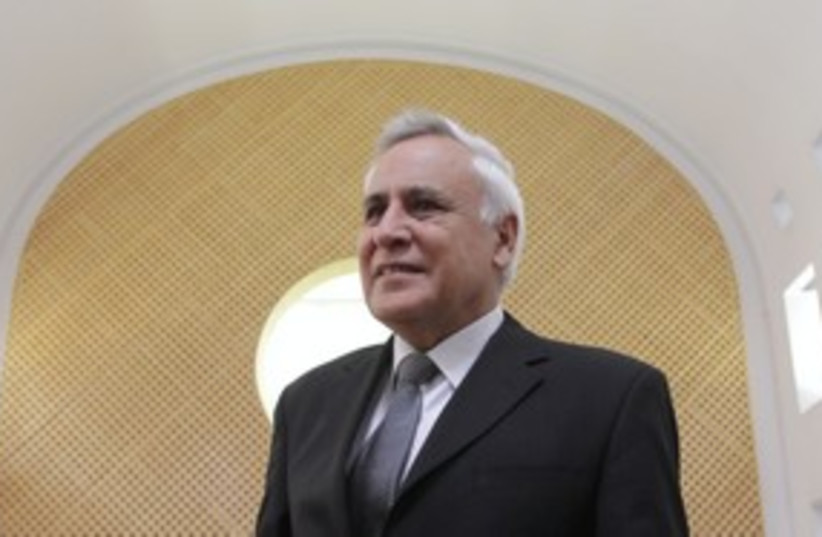 Former president Moshe Katsav in court 311 (photo credit: Alex Kolomoiski / Pool)