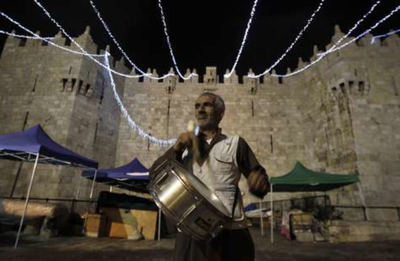 Palestinian call to Ramadan 521 (photo credit: REUTERS/Ammar Awad)