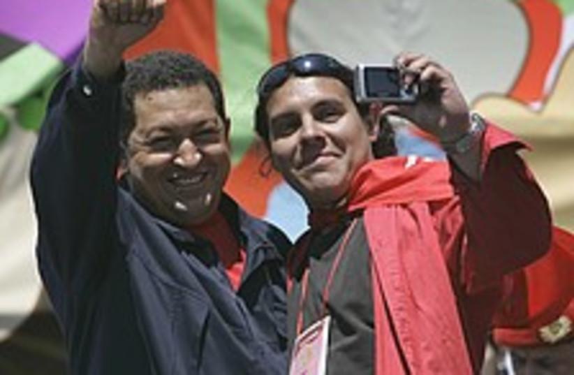 Chavez salutes 224.88 (photo credit: AP)
