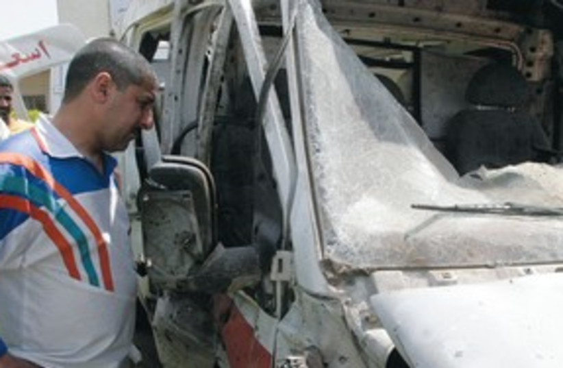 Destroyed ambulance in Iraq311 (photo credit: REUTERS)