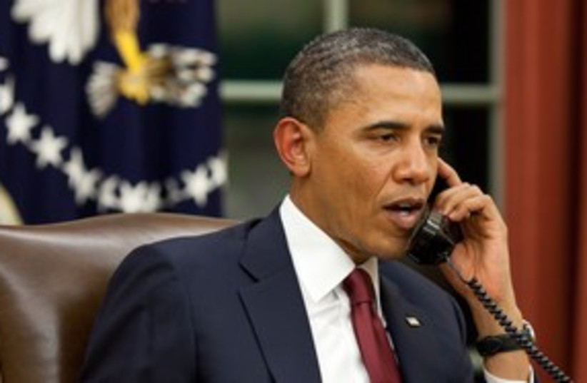 US President Barack Obama speaks on the phone 311 (R) (photo credit: Reuters / White House)