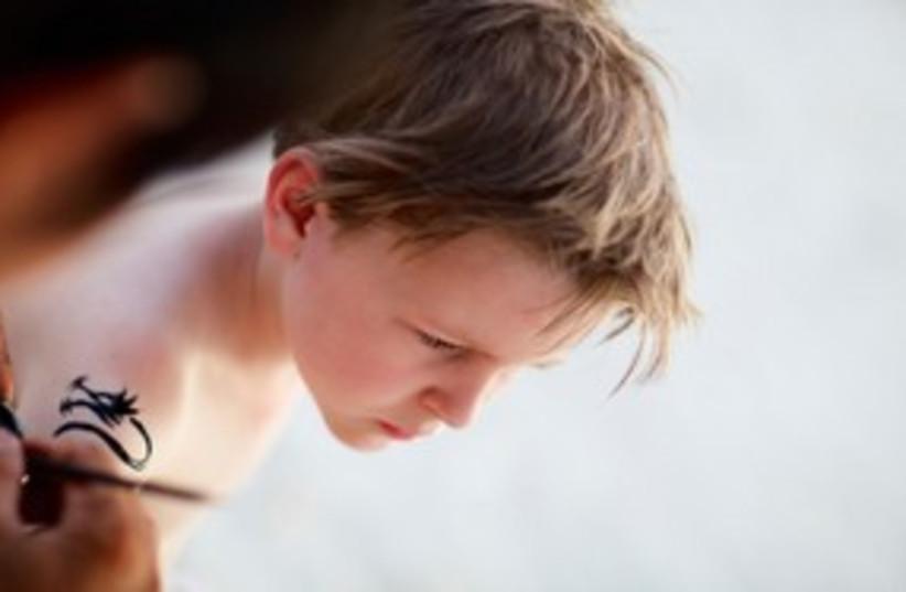 Kid child with temporary henna tattoo 311 (photo credit: Thinkstock/Imagebank)