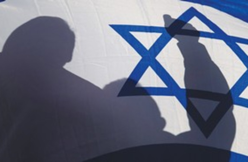 Supporter waves flag at pro-Israel rally in Honduras (photo credit: REUTERS)