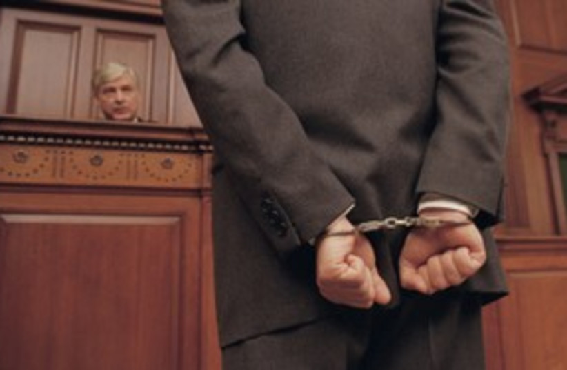 Suspect in court judge handcuffs arrest hearing 311 (photo credit: Thinkstock/Imagebank)