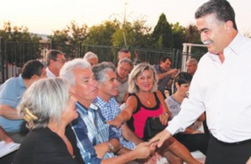 Amir Peretz greets supporters311 (photo credit: Marc Israel Sellem/The Jerusalem Post))