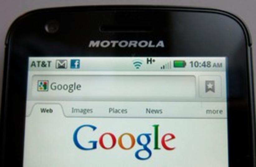 Motorola Droid phone is seen displaying Google search (R) (photo credit: REUTERS/Brendan McDermid)
