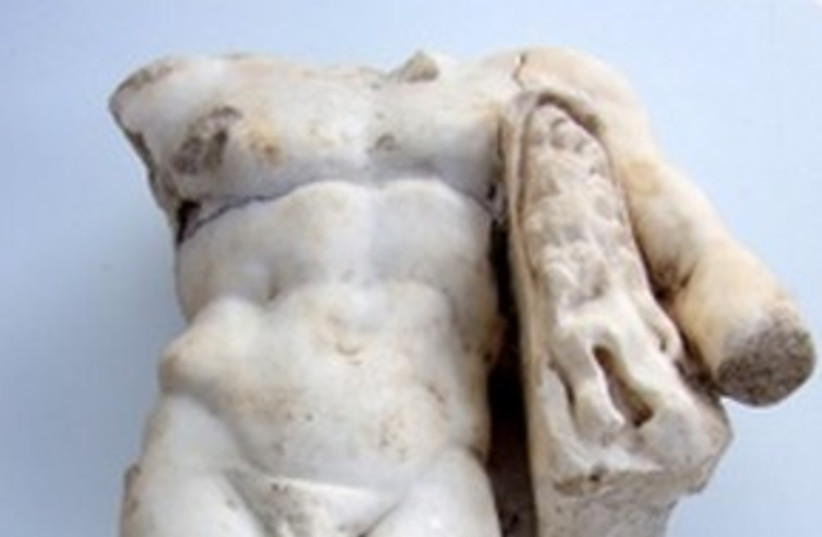 Uncovered Hurcules statue 311 (photo credit: Israel Antiquities Authority)