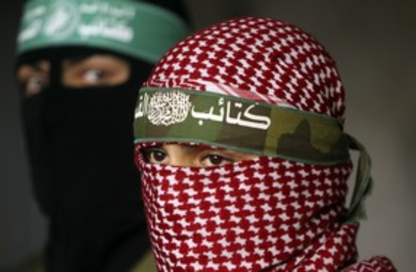 Masked Hamas terrorists 311 (R) (photo credit: Mohammed Salem / Reuters)