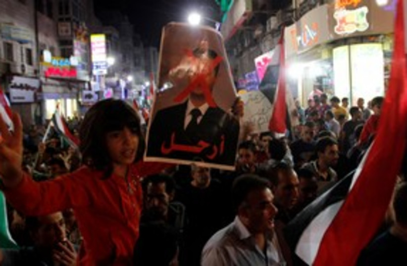 Palestinians at an anti-Assad rally in Ramallah 311 (R) (photo credit: REUTERS/Mohamad Torokman)