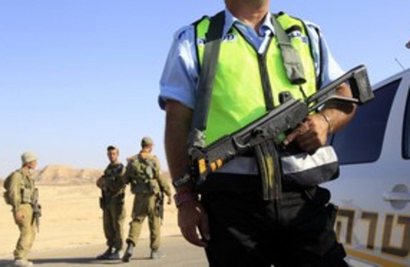 Police, soldiers after Eilat attack 311 (photo credit: REUTERS/Ronen Zvulun)