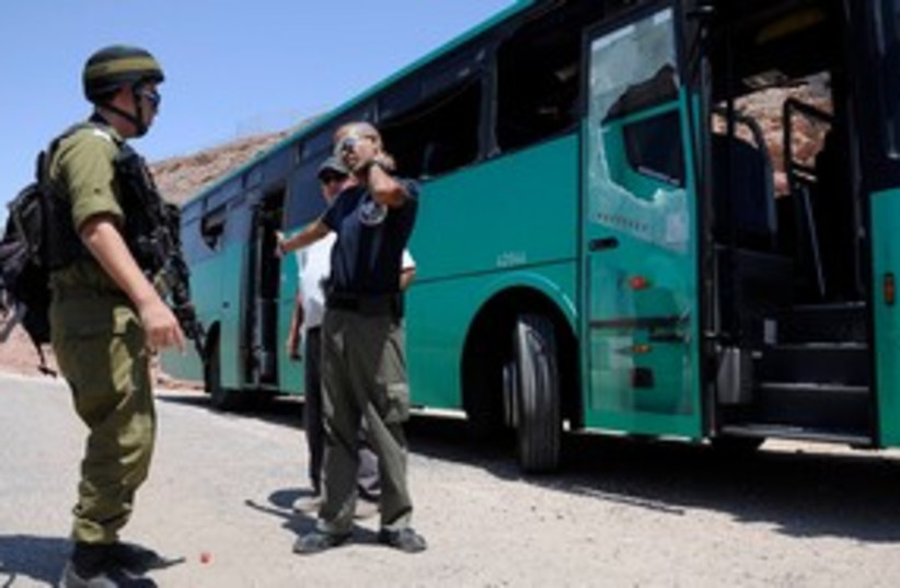 Security forces standing next to an attacked bus 311 (R) (photo credit: REUTERS/Lior Grundman)