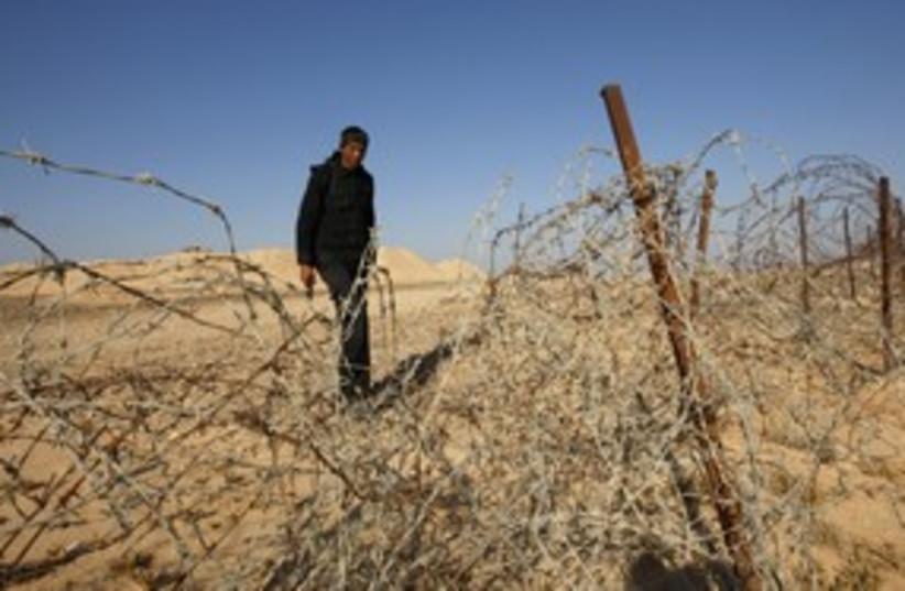 An Egyptian soldier on the Israeli border in Sinai 311 (R) (photo credit: Ronen Zvulun / Reuters)