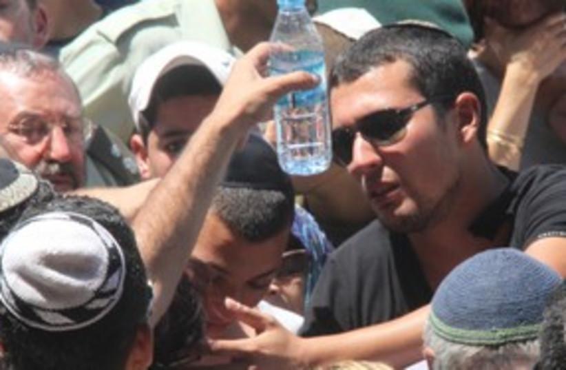 Tal Avrahami at father Pascal's funeral 311 (photo credit: Tovah Lazaroff)