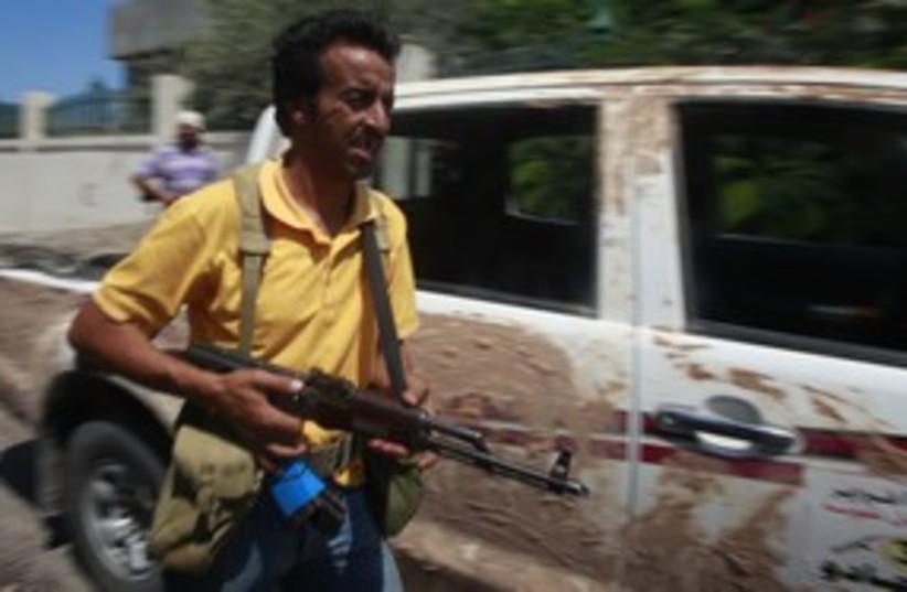 Libyan rebel in Zawiyah_311 (photo credit: Reuters)