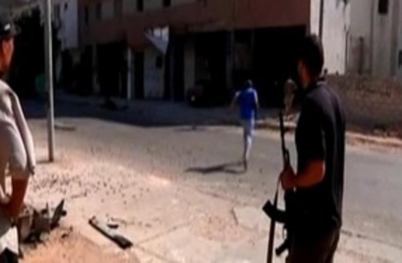 Libyan rebels in Tripoli 311 (R) (photo credit: REUTERS)