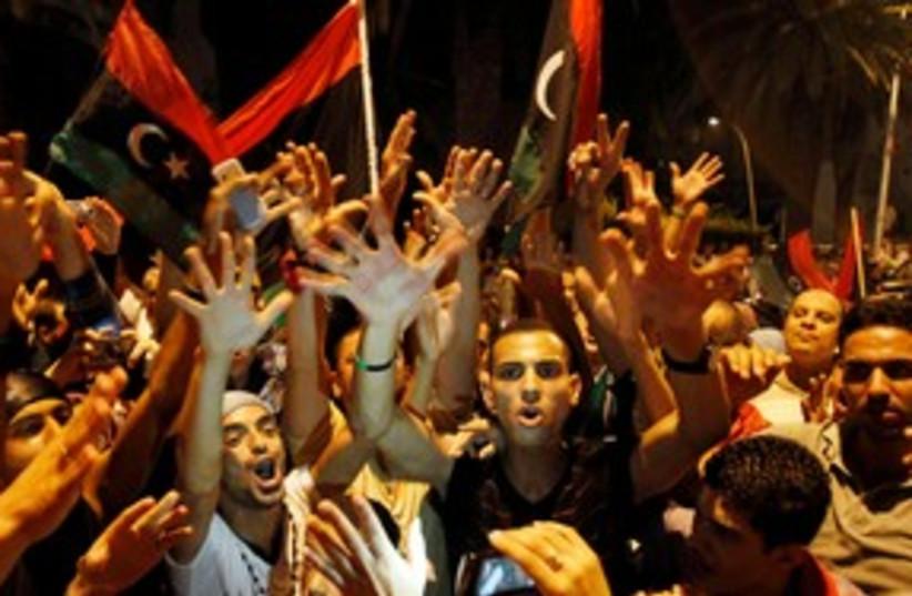 Libyans celebrating the capture of Tripoli 311 (R) (photo credit: REUTERS/Zoubeir Souissi)