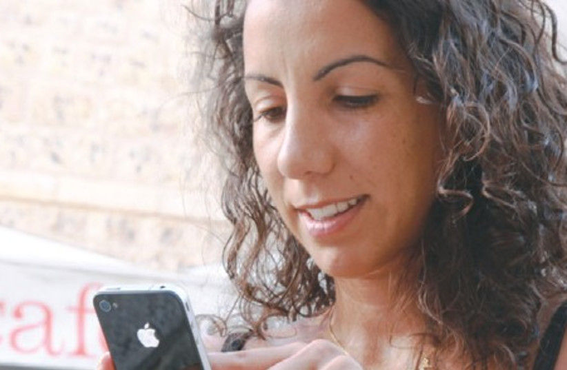 Woman with iPhone 311 (photo credit: Marc Israel Sellem/The Jerusalem Post)