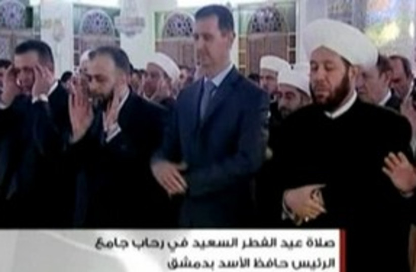 Assad praying 311 (photo credit: REUTERS)