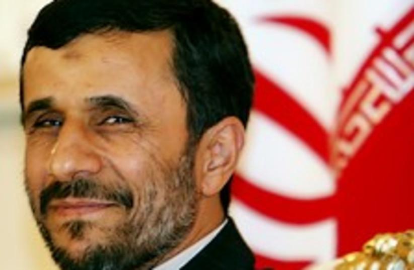 Ahmadinejad cheeky grin  (photo credit: AP)