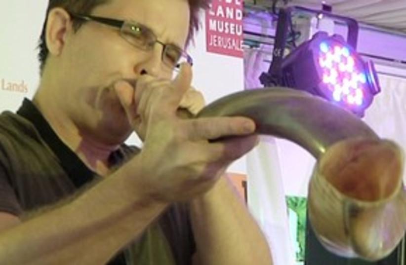 Man blowing a shofar 311 (photo credit: iTravelJerusalem)