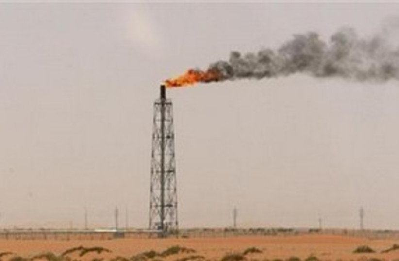 Oil derrick 311 (photo credit: Reuters/Ali Jarekji)