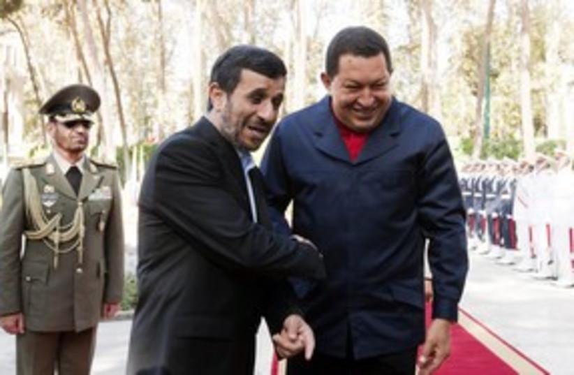 Iran's Ahmadinejad and Venezuela's Chavez 311 (R) (photo credit: Raheb Homavandi / Reuters)
