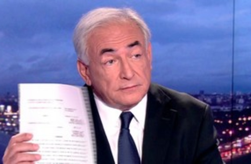 Dominique Strauss-Kahn appears on prime time news show (photo credit: REUTERS/TF1/Handout )