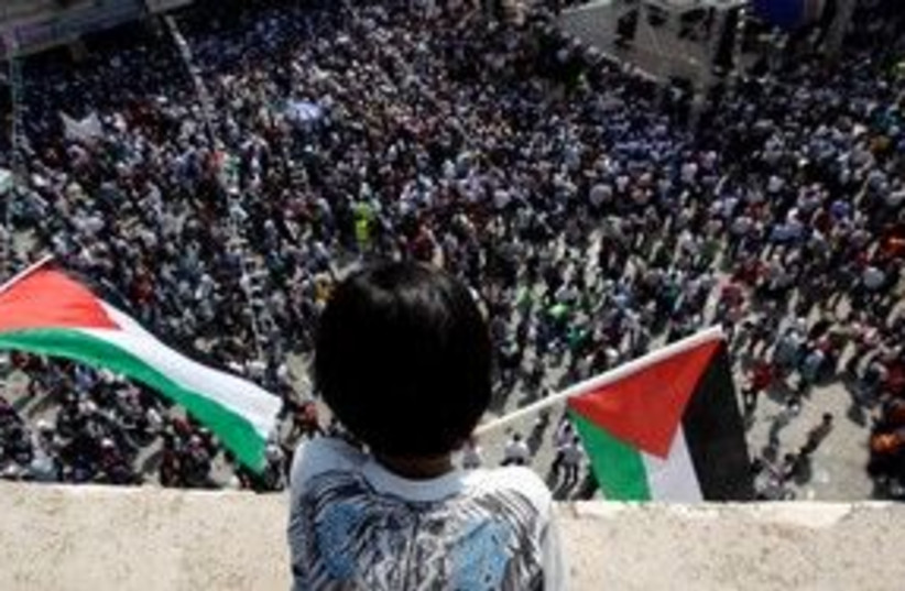Palestinian boy looks over rally in Ramallah 311 (R) (photo credit: REUTERS/Darren Whiteside)