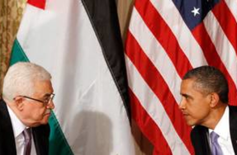 US President Obama with PA President Abbas 311 (R) (photo credit: REUTERS/Kevin Lamarque)