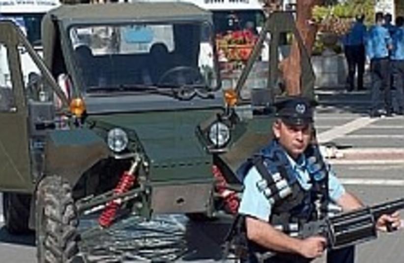 police and gun 224 (photo credit: Yaakov Katz [file])