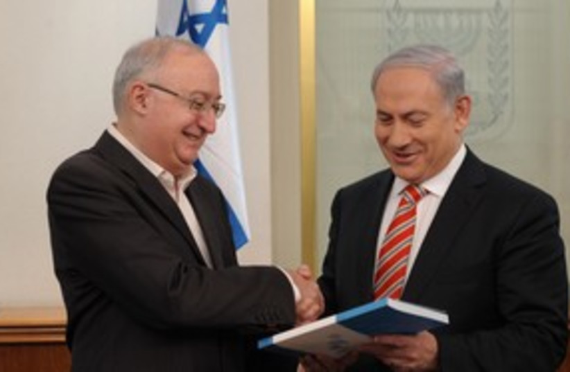 Prof. Trajtenberg hands recommendations to PM Netanyahu [file] (photo credit: GPO)