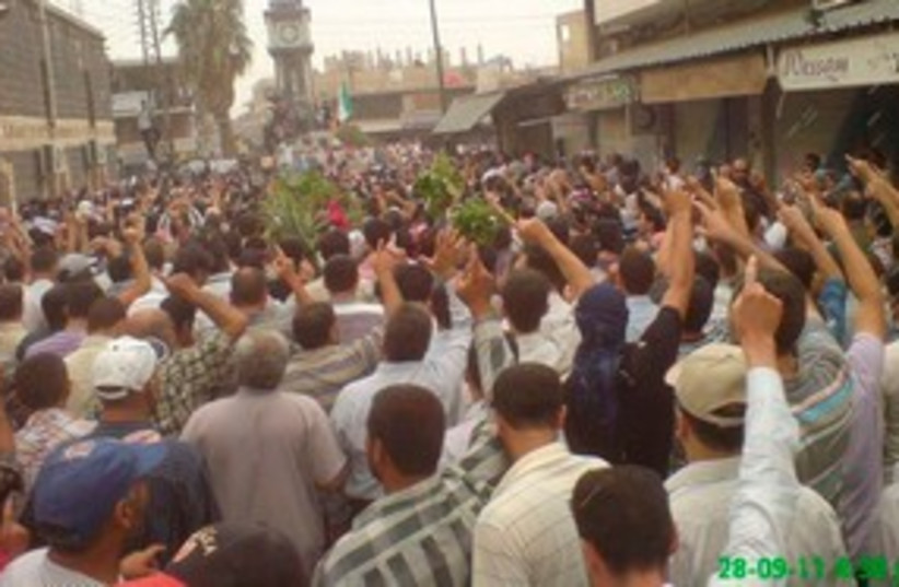 Anti-Assad protesters in Homs 311 (R) (photo credit: REUTERS/Handout)