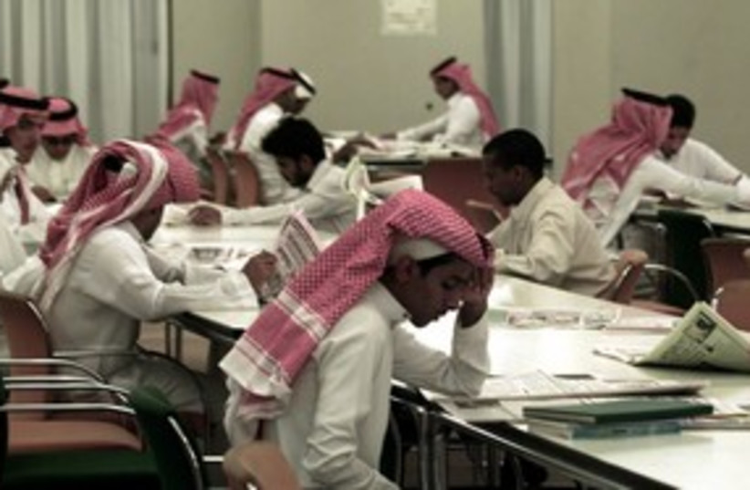 Saudi Arabian students reading 311 (R) (photo credit: REUTERS)