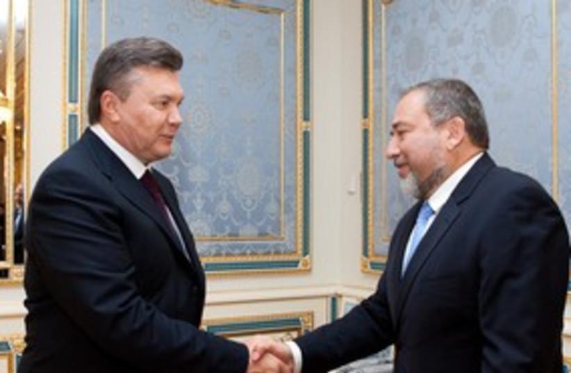 Ukraine's President Viktor Yanukovich with Lieberman 311 (photo credit: REUTERS/Mykhailo Markiv/Presidential Press Service)