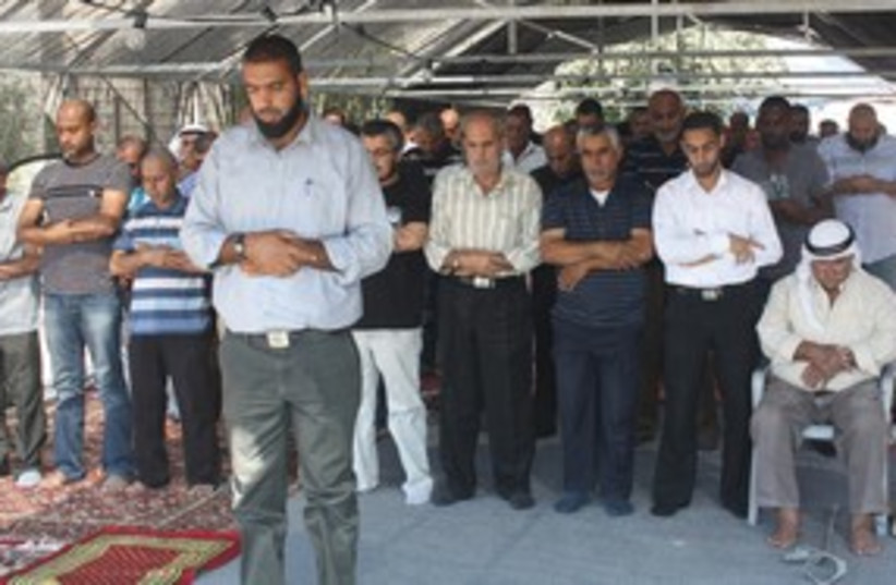 Tuba Zanghariya residents pray outside bured mosque 311 (photo credit: Ben Hartman)
