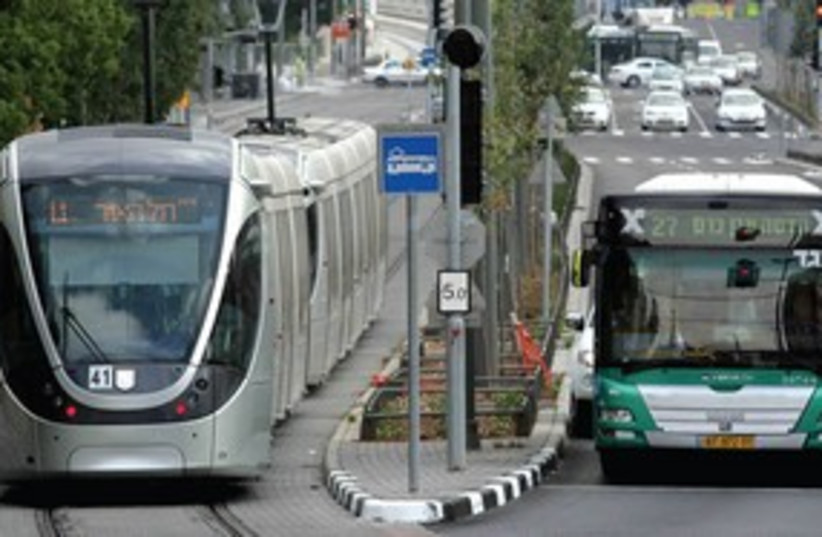 Jerusalem light rail with Egged bus 311 (photo credit: Abir Sultan)