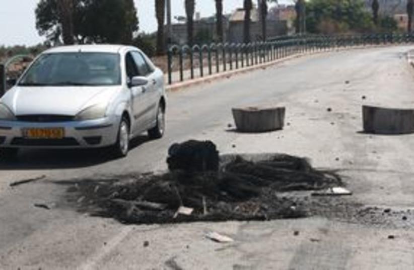 Burned tires in Tuba Zanghariya 311 (photo credit: Ben Hartman)