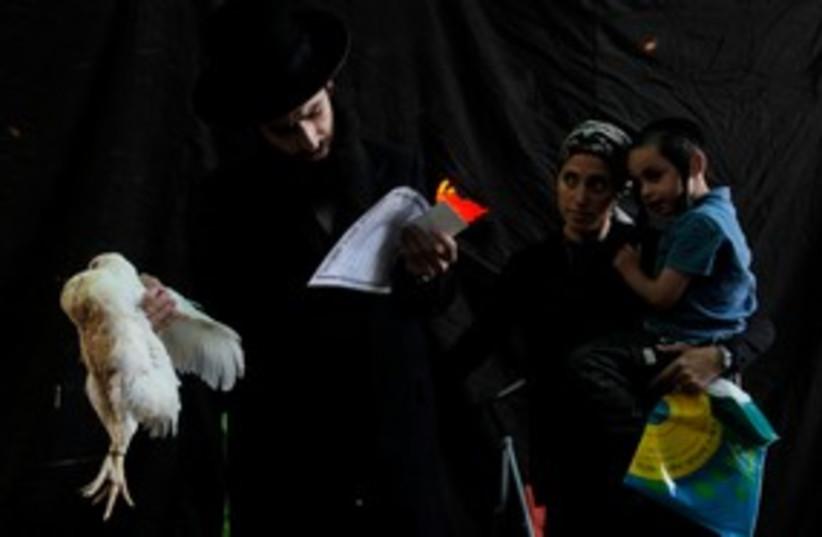 Kapparot ceremonies in Jerusalem 311 (photo credit: REUTERS/Ammar Awad)
