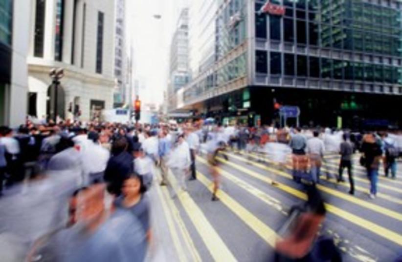 Pedestrians crossing street 311 (photo credit: Thinkstock/Imagebank)
