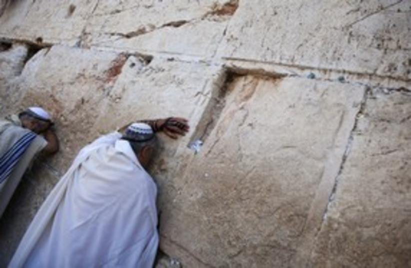 Jews praying at the Western Wall kotel 311 (R) (photo credit: Darren Whiteside / Reuters)