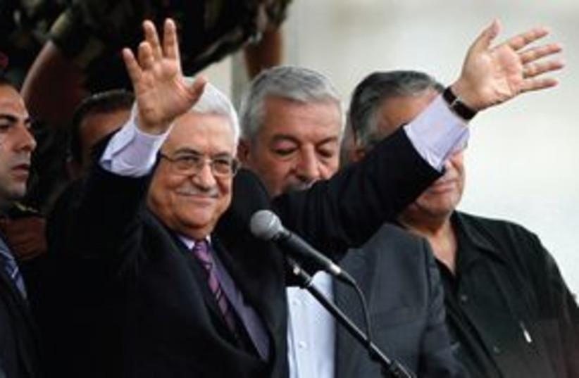 PA President Mahmoud Abbas waiving 311 (R) (photo credit: REUTERS)