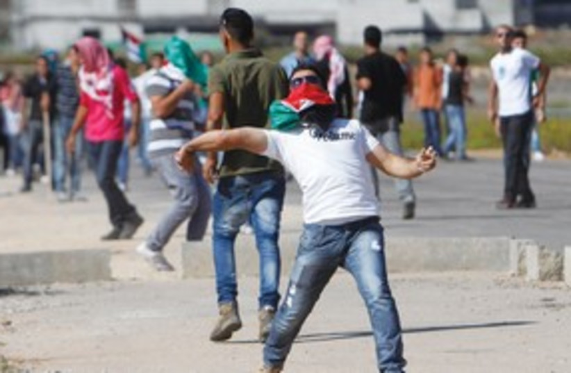 Ramallah Rock Throwing 311 (photo credit: Mohamad Torokman/Reuters)