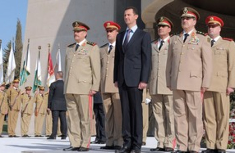 Syrian President Bashar Assad with his army generals 311 (R) (photo credit: Reuters)
