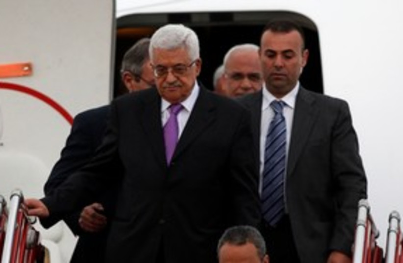 PA President Mahmoud Abbas arrives in Colombia 311 (R) (photo credit: REUTERS/John Vizcaino)
