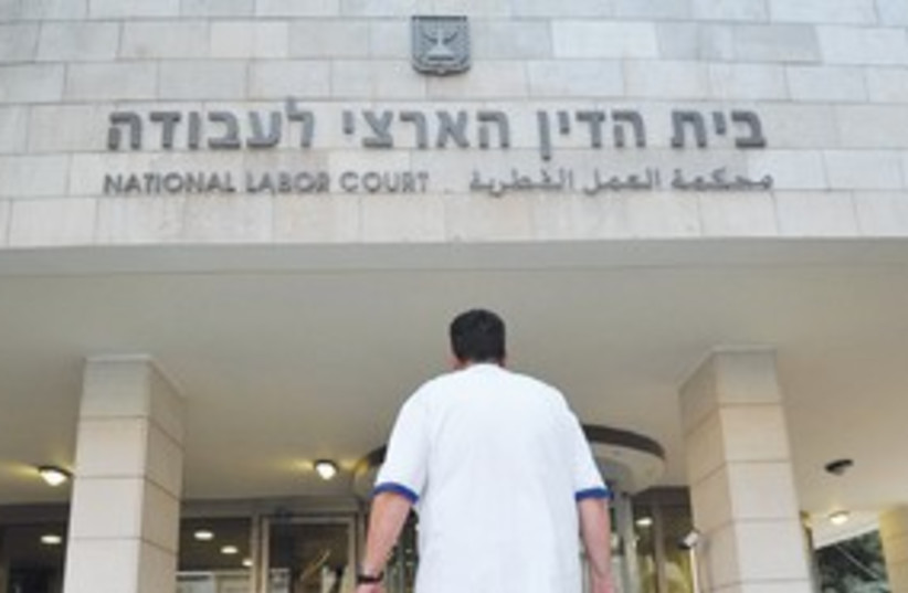 Doctor walks to national labor court_311 (photo credit: Marc Israel Sellem)