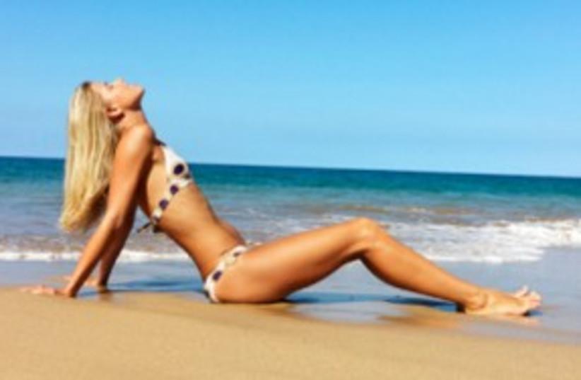 sunbathing woman_311 (photo credit: Thinkstock/Imagebank)
